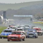 The Group 1 Touring Car field heads into the first corner at the 2014 Goodwood Member's Meeting